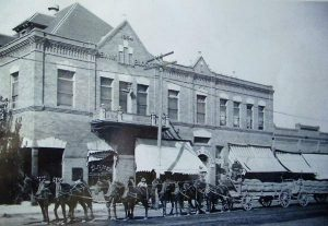 Harrington Opera House_and Grain Wagons - early 1900s