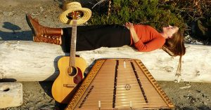 Carolyn Cruso with guitar and hammered dulcimer