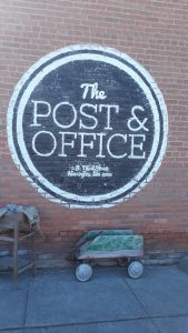The Post & Office - sign on brick wall