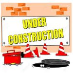Under-construction sign on brick wall
