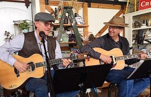 Randy Beamer and Lynn Caddell playing guitar at the Post & Office